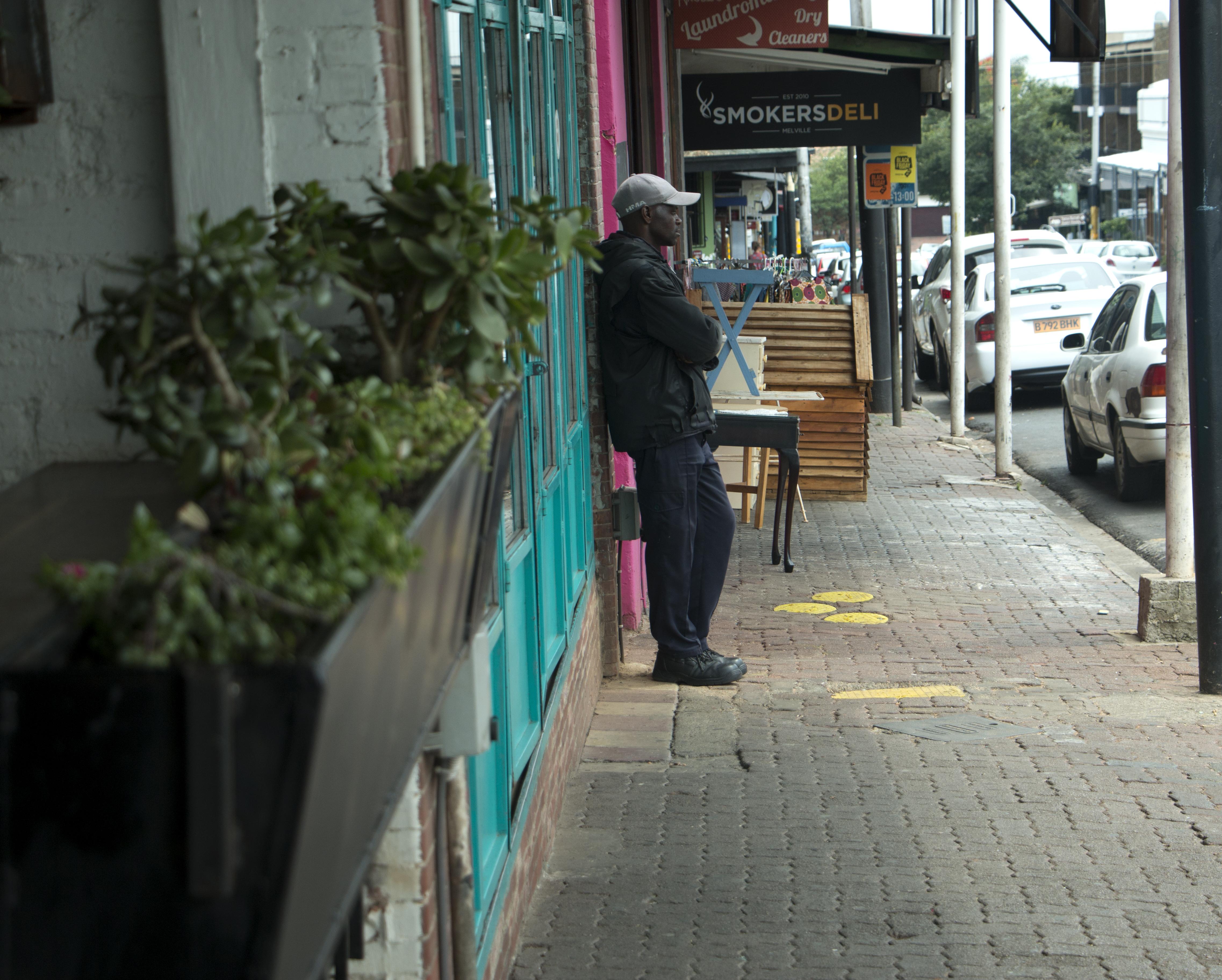Man on sidewalk
